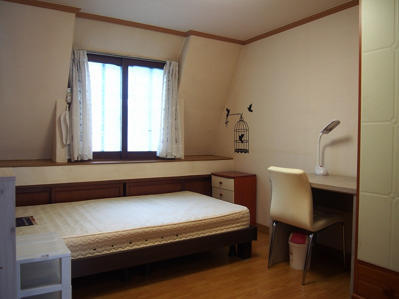 Camera da letto share house in Corea